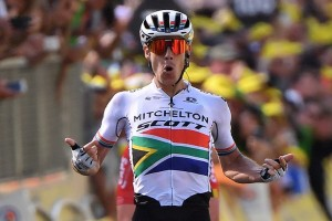 South Africa's Daryl Impey celebrates as he wins on the finish line of the ninth stage of the 106th edition of the Tour de France cycling race between Saint-Etienne and Brioude, in Brioude, eastern France, on July 14, 2019. (Photo by Marco Bertorello / AFP)